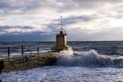 Lighthouse dinovi in the sea stock image