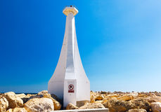 Small lighthouse  in Zygi Marina. Cyprus. Royalty Free Stock Images