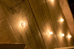 Small lights turned on a wooden surface. Royalty Free Stock Photo