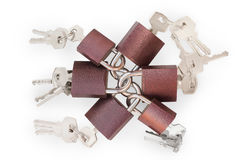 Small linked padlocks with keys isolated with clipping path Stock Photo