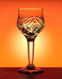 Small liqueur glass at the orange gradiend background Royalty Free Stock Photography