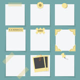 Small little attached blank paper notes on teal background Royalty Free Stock Photo