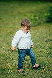Small little boy walking and play outdoors Royalty Free Stock Image