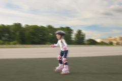 Small little caucasian girl skating Stock Photo
