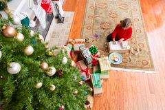 Small little girl sitting writing to Santa Claus Royalty Free Stock Photos