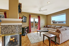 Small living area with fireplace and walkout deck Stock Images