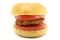 Small loaf with cutlet and tomato Stock Photo