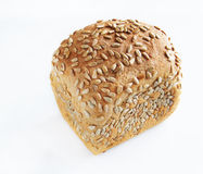 Small loaf dusted with seeds of sunflower Stock Photography