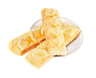 Small loafs with honey and a lemon. Lie on a saucer Royalty Free Stock Photography