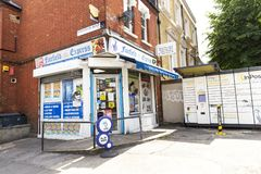 A small local English corner grocery shop. London UK - 20 June 2019: A small corner grocery local shops spread convenience all around London, UK royalty free stock image