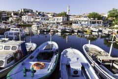 Small local fishing boats of Bozcaada Island port Royalty Free Stock Photo