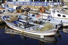 Small local fishing boats closeup in Bozcaada Island harbor Royalty Free Stock Photo