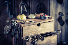 Small locksmiths workshop with tools, locks and keys Royalty Free Stock Image