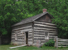 Small log cabin in the trees. Stock Photo