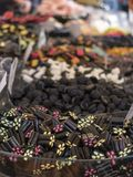 Small logs of licorice with a filling of fruit in the foreground. Small logs of licorice with a filling of t in the foreground. In the background, boxes with Royalty Free Stock Photos