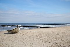 A lonely fishing boat on the beach of Zempin Royalty Free Stock Photos