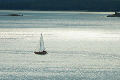 Small lonely yacht against sea Stock Photos