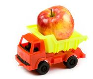 Small lorry with a big red apple Stock Images