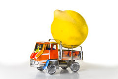 Small lorry loaded with one big lemon Royalty Free Stock Images