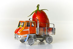 Small lorry loaded with one big red tomato Royalty Free Stock Image