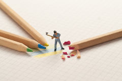 Small lumberjack sharp pencils. School concept Stock Photos