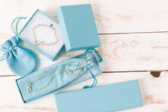 Small luxury gift box. And bag with jewelry Stock Image