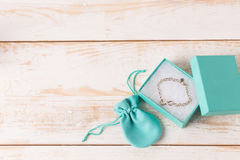 Small luxury gift box. And bag with jewelry Stock Photos