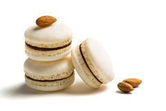 Small macaroons with almond on white background royalty free stock image