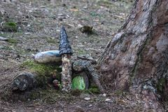Small magical garden of the gnomes in the forest. Small magical garden of the gnomes in the trees stock photo