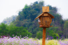 A small mailbox in the flower field Royalty Free Stock Photos