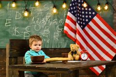 Small male student child near a flag of america. Small male student child near a flag of america stock images