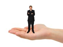 Small man in hand. Isolated on white background stock images