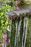Small man made waterfall in countryside Stock Photos