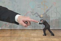 Small man pushing against big man hand Royalty Free Stock Photos
