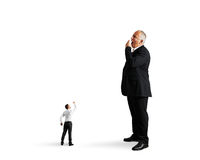Small man showing fist to big bored businessman. Small men showing fist to big bored businessman. isolated on white background Royalty Free Stock Photos