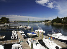 Small Marina with Boats. A small marina in the river with several boats Stock Photos