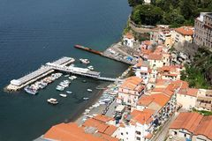 Small marina  at Sorrento Italy and buildings. The small marina at Sorrento Italy showing boats water and buildings Royalty Free Stock Photography
