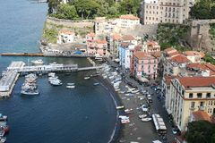 Small Marina at Sorrento Italy. The small marina at Sorrento Italy showing boats water and buildings stock photos