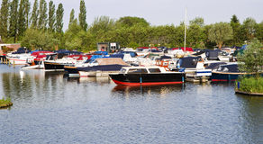 Small marina with yachts. Yachts in small marina on a beautiful sunny morning royalty free stock photo