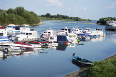 Small marine on river with colorful boats Royalty Free Stock Images