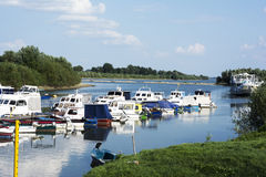Small marine on river with colorful boats Stock Photos