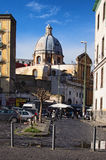The small market in the square near the ancient cathedral Stock Photography
