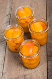 Small mason jars of sliced peaches Stock Photo