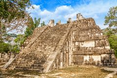 Small mayan pyramid in the forest, Chichen Itza archaeological s. Ite, Yucatan, Mexico Stock Photos