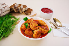 Small meat balls with peas and parsley. Fried noisettes with and rye bread Stock Image