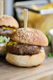 Small meat burger sliders on wooden table Stock Image