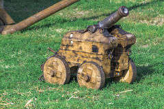 Small medieval cannon. On a field Royalty Free Stock Image