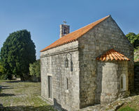 Small medieval church and tree Royalty Free Stock Images