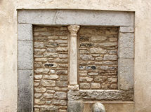 Small medieval column, in a stone wall Royalty Free Stock Photos