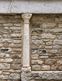 Small medieval column, in a stone wall Royalty Free Stock Image